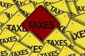 Taxes written on multiple road sign — Stock Photo