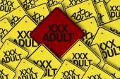 XXX Adult written on multiple road sign — Stockfoto