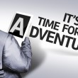 Business man with the text It's Time For an Adventure in a concept image — Stock Photo #54422305