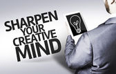 Business man with the text Sharpen your Creative Mind in a concept image — Stock Photo