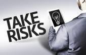 Business man with the text Take Risks in a concept image — Stock Photo