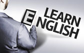 Business man with the text Learn English in a concept image — Stock fotografie