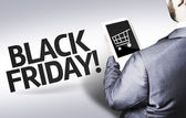 Business man with the text Black Friday in a concept image — Stock Photo