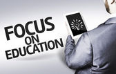 Business man with the text Focus on Education in a concept image — 图库照片
