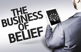 Business man with the text The Business of Belief in a concept image — Stock Photo