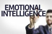 Business man pointing to transparent board with text: Emotional Intelligence — Stock Photo