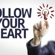 Board with text: Follow your Heart — Stock Photo #54626867
