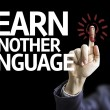 Business man pointing the text: Learn Another Language — Stock Photo #54627507
