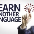 Business man pointing the text: Learn Another Language — Stock Photo #54627513