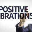 Business man pointing the text: Positive Vibrations — Stock Photo #54627985
