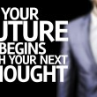Your Future Begins With Your Next Thought written on a board — Stock Photo #54629453