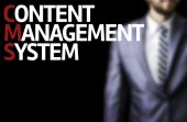 Content Management System written on a board with a business man — Stock fotografie