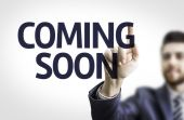 Business man pointing the text: Coming Soon — Stock Photo