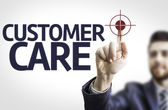 Business man pointing the text: Customer Care — Stock Photo