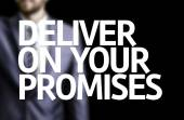 Deliver on your Promises written on a board with a business man — Stock Photo