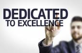 Business man pointing the text: Dedicated to Excellence — Stock Photo