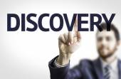 Business man pointing text: Discovery — Stock Photo