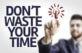 Business man pointing the text: Don't Waste Your Time — Stock Photo
