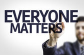 Business man pointing  text: Everyone Matters — Stock Photo