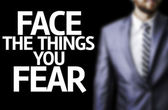Face the Things you Fear written on a board — Stock Photo