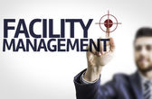 Board with text: Facility Management — Stock Photo