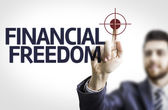 Board with text: Financial Freedom — Stock Photo