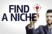Board with text: Find A Niche — Stock Photo