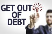 Board with text: Get Out of Debt — Stock Photo