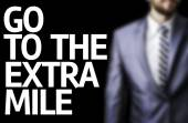Board with text: Go To Extra Mile — Stok fotoğraf