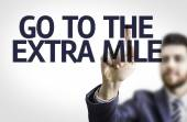 Board with text: Go To Extra Mile — Stock Photo