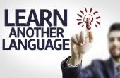 Business man pointing the text: Learn Another Language — Stock Photo