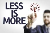 Business man pointing the text:Less is More — Fotografia Stock