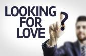 Business man pointing the text: Looking for Love? — Stock Photo