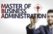 Business man pointing the text: MBA — Stock Photo