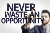 Board with text: Never Waste An Opportunity — Stock Photo