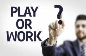Business man pointing the text: Play or Work? — Stock Photo