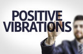 Business man pointing the text: Positive Vibrations — Стоковое фото