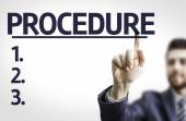 Business man pointing the text: Procedure — Stock Photo