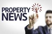Business man pointing the text: Property News — Stock Photo