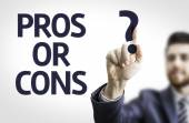 Business man pointing the text: Pros or Cons? — Stock Photo