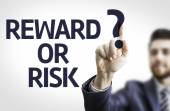 Business man pointing the text: Reward or Risk? — Stock Photo