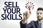 Business man pointing the text: Sell Your Skills — Foto Stock