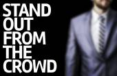 Stand Out From The Crowd written on a board — Stock Photo
