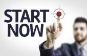 Business man pointing the with text: Start Now — Stock Photo