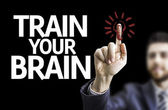 Business man pointing the text: Train your Brain — Stock Photo