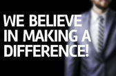 We Believe in Making a Difference written on a board — Stock Photo