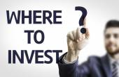 Business man pointing the text: Where to Invest? — Foto de Stock