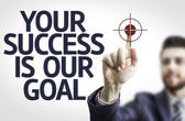 Board with text: Your Success Is Our Goal — Stock Photo