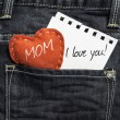 Mom I love you! written on a peace of paper — Stock Photo #54636811