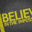 Believe in the Impossible written on road — Stock Photo #54639411
